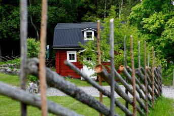 Bilden föreställer ett rött hus