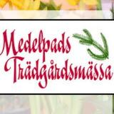Bilden föreställer loggan för Medelpads Trädgårdsmässa