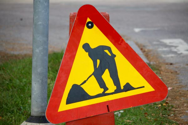 Bilden föreställer en skylt för grävarbete