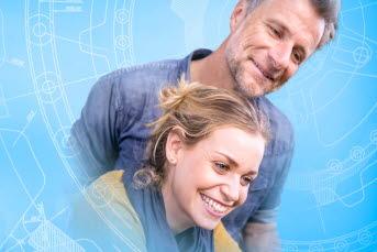 Bilden föreställer en man och en kvinna som tittar nedåt.